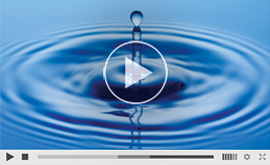 Screenshot of a a video with a drop of water hitting a bigger body of water